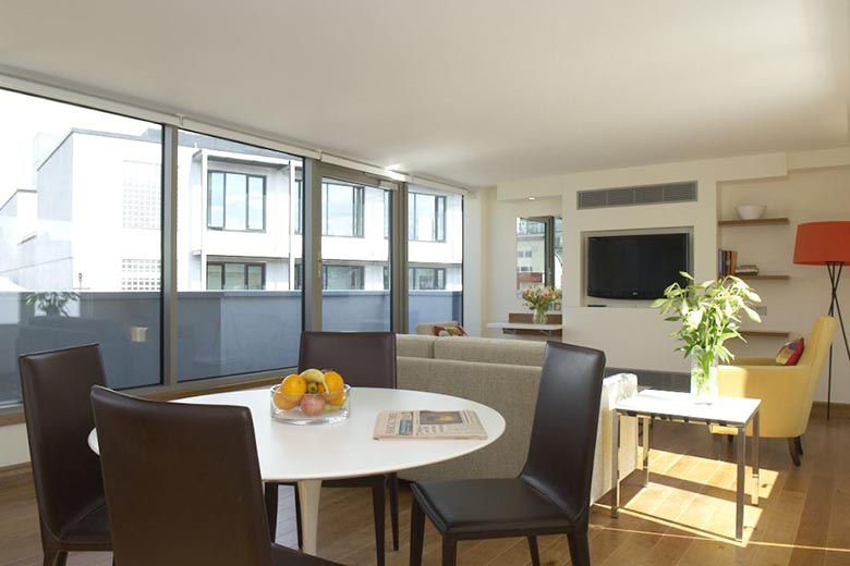 Serviced apartments clerkenwell london turnmill street apartments the spacious modern lounge and dining area of the penthouse apartment malvernweather Choice Image