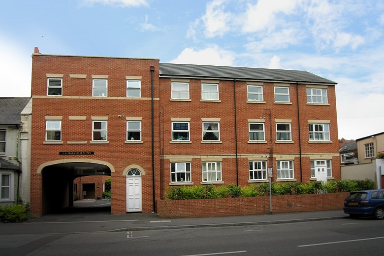 A modern yet traditional red brick building