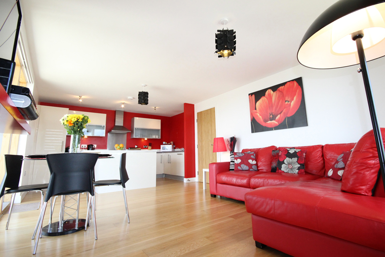 The bright open plan kitchen and living area of the two bedroom superior apartment