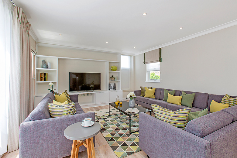 A relaxing and colourful living room in a three bedroom penthouse