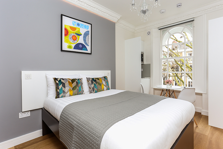 A bright and colourful small double studio apartment