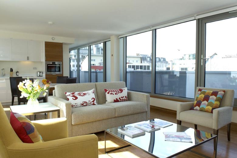 Another view of the spacious and bright penthouse lounge available at The Rockwell Turnmill Street