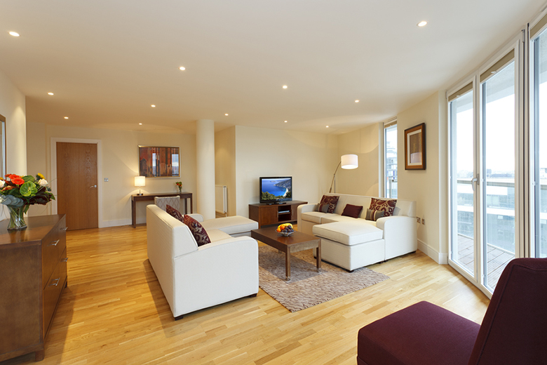A spacious and modern lounge at Trinity Tower Apartments
