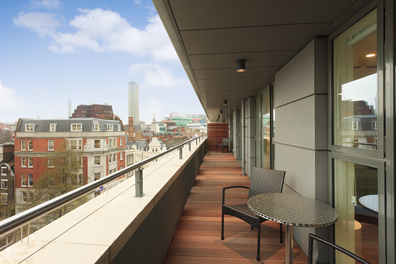 A spacious and bright terrace balcony at St Martins Apartments