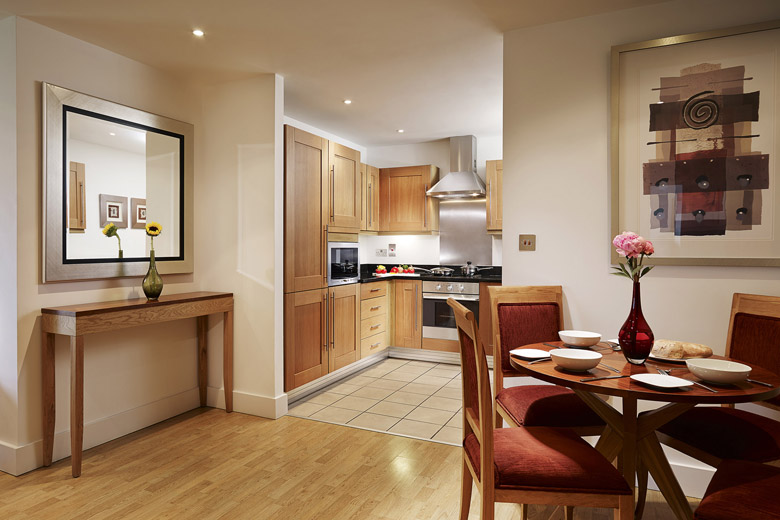 A typical modern and trendy kitchen and dining area at Marlin Stratford