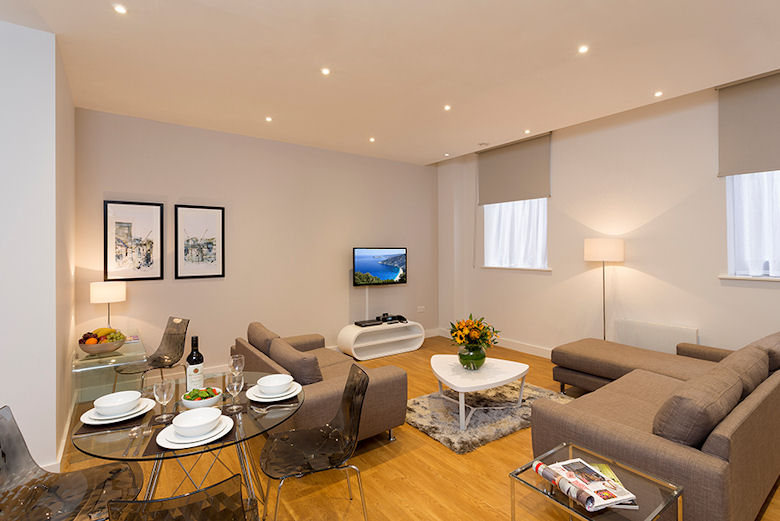 A spacious, smart living and dining area at Picadilly Place Apartments