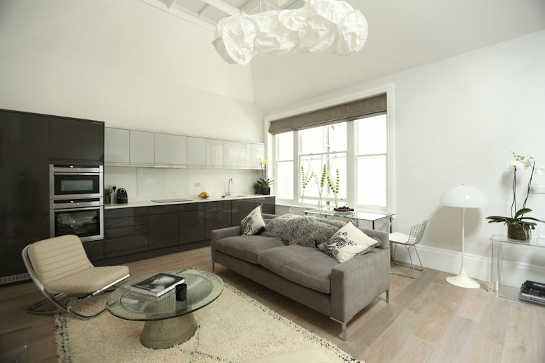 A typically luxurious lounge and kitchen at 56 Welbeck Street