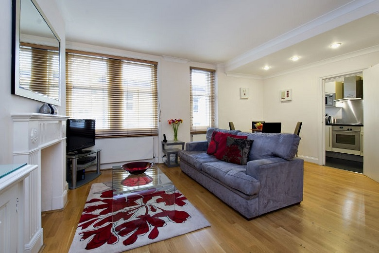 A comfortable, open plan living area with a large flat screen television