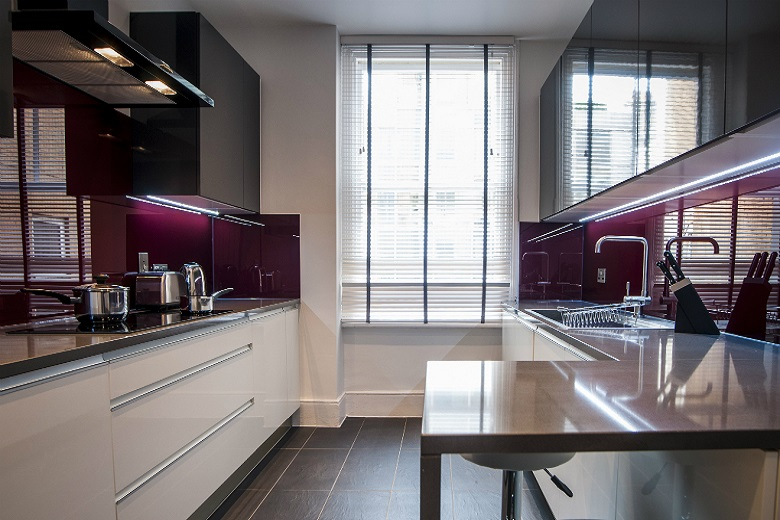 A full-equipped kitchen at West End Garrick Mansions with breakfast bar