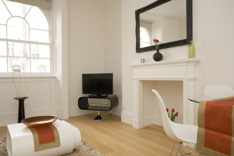 A gorgeous neutrally decorated reception room at the Marylebone Apartments